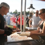 Serving ribs at ribfest Ontario